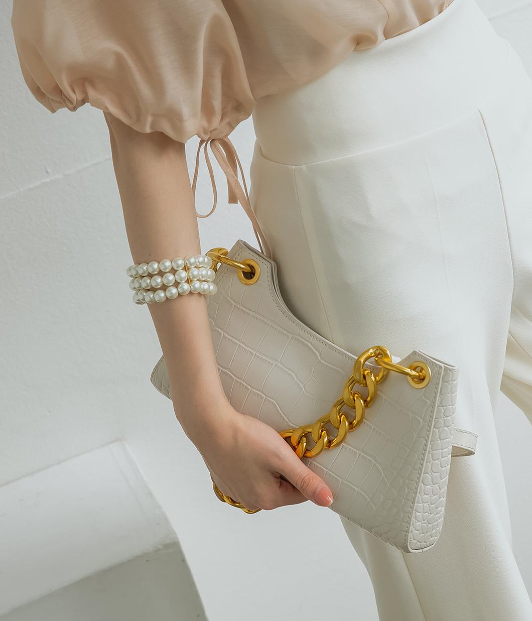 時尚魅力金屬掛飾壓紋肩背包